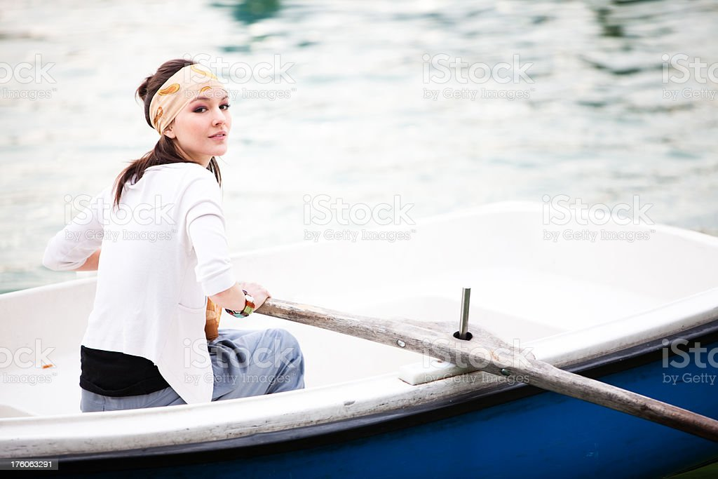 Young beautiful woman rowing a boat in Madrid royalty-free stock photo