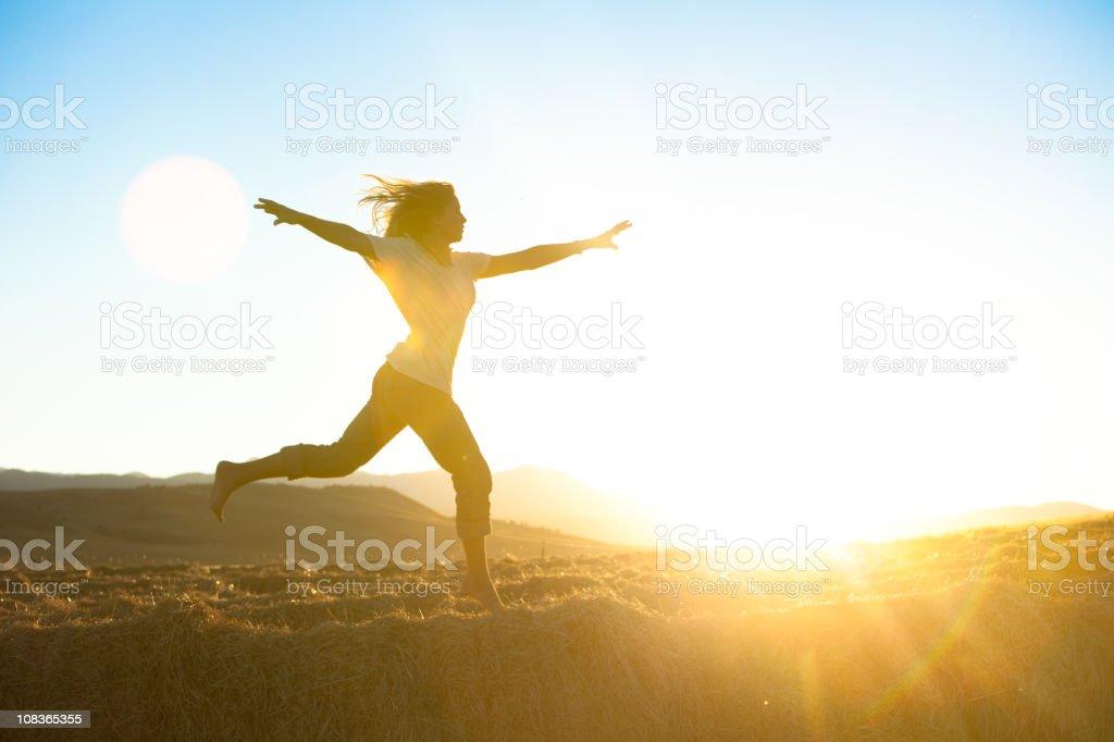 Young beautiful woman running barefoot royalty-free stock photo