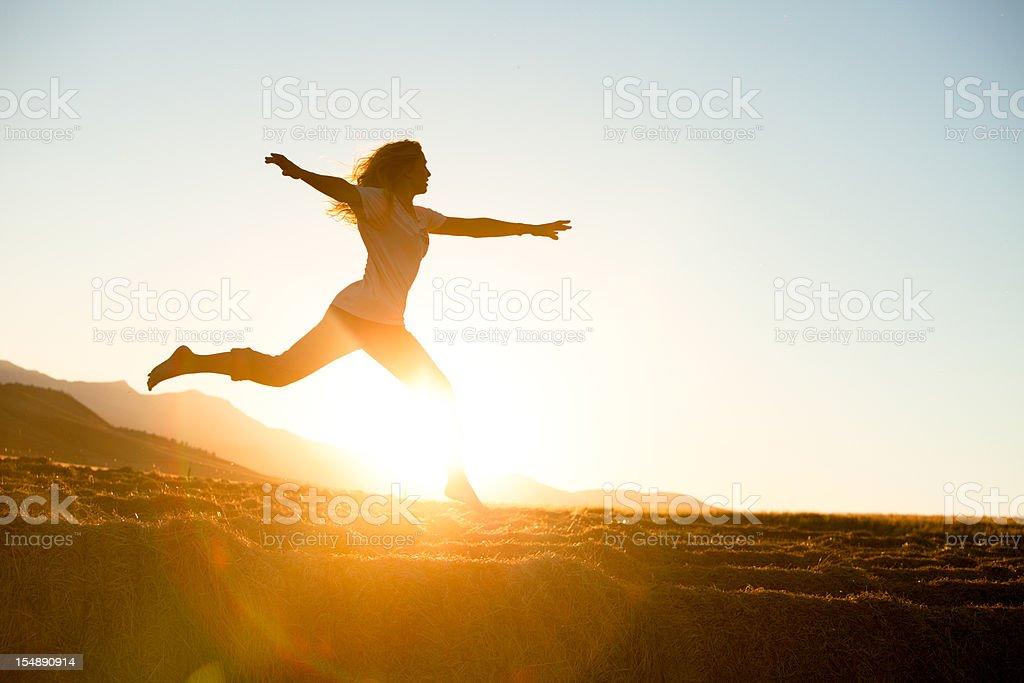 Young beautiful woman running barefoot stock photo