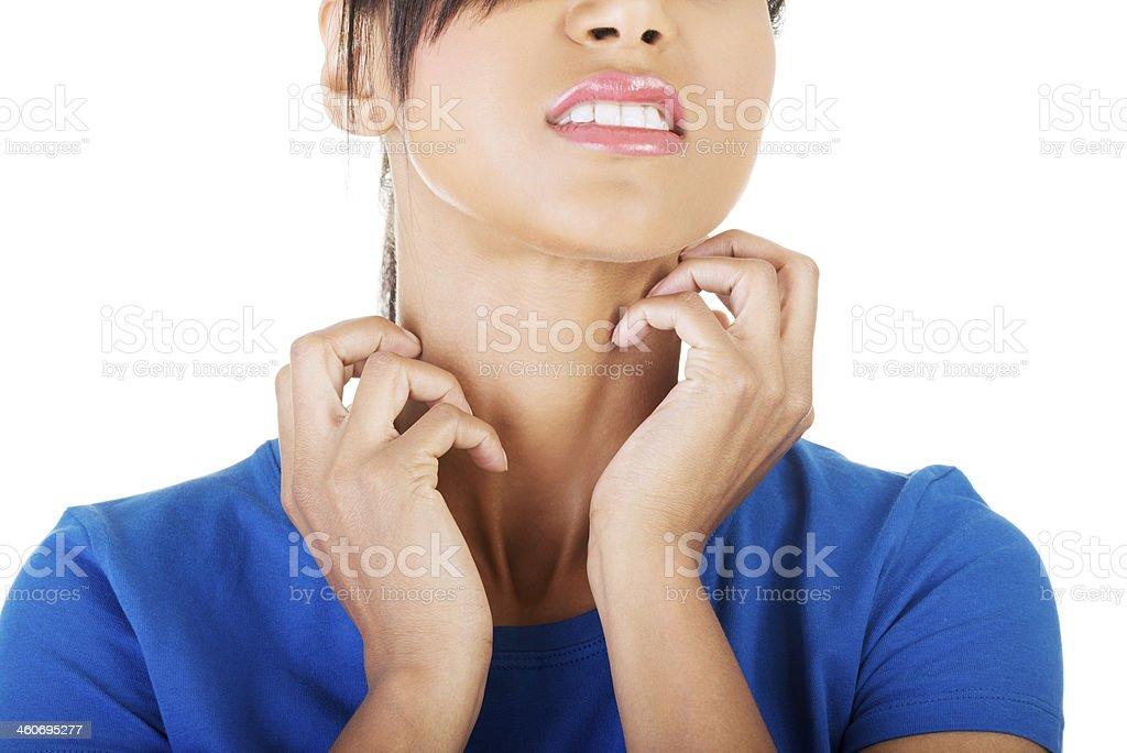 Young beautiful woman scratching her self. stock photo