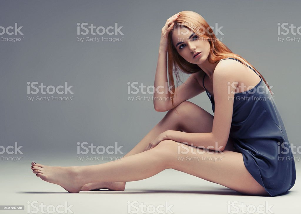 Young beautiful woman sexy on gray background stock photo
