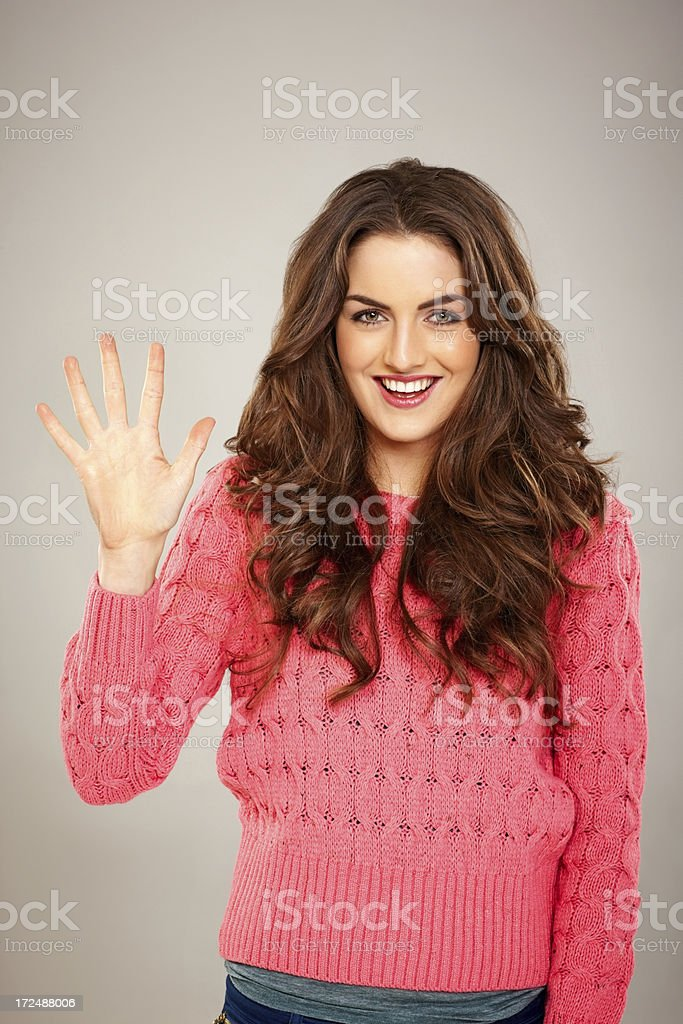 Young beautiful woman showing five fingers royalty-free stock photo