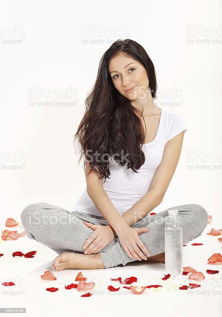Young beautiful woman sitting in lotus pose royalty-free stock photo