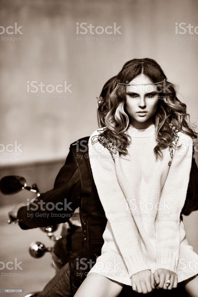 Young beautiful woman sitting on the bike royalty-free stock photo