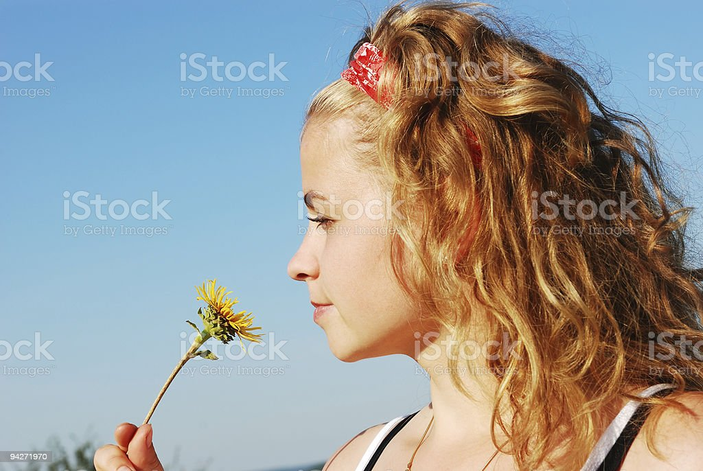 Young beautiful woman smiling a flower stock photo