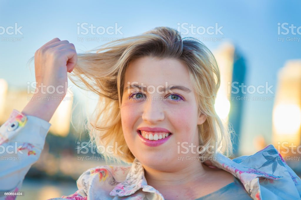 Young beautiful woman smiling stock photo