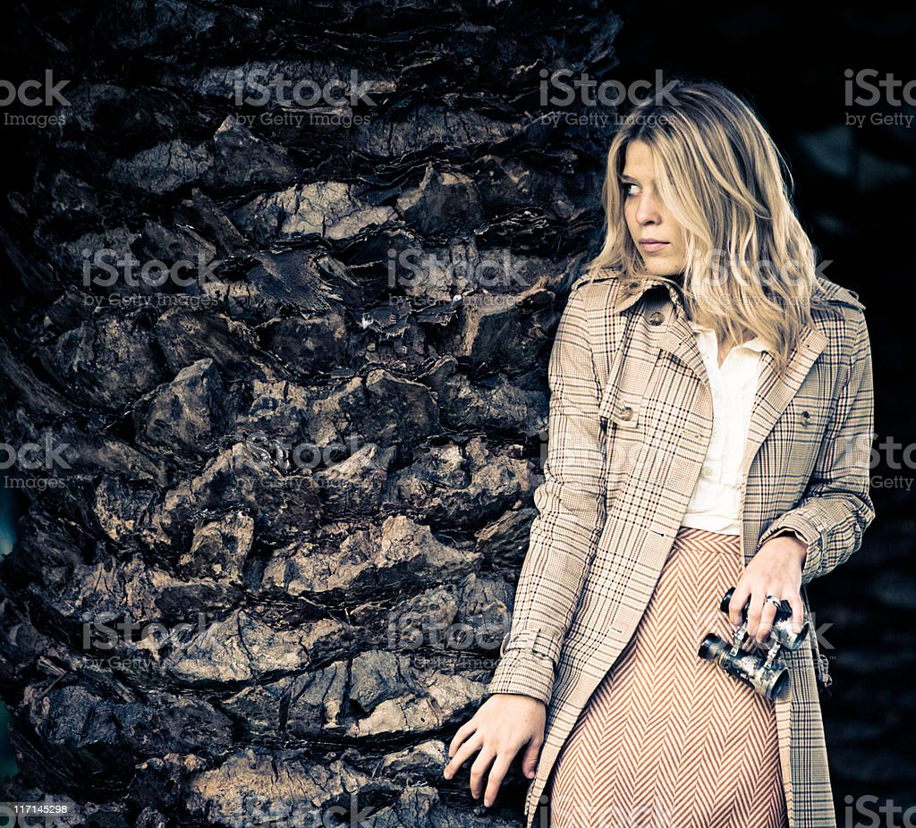 Young beautiful woman sneaking around royalty-free stock photo