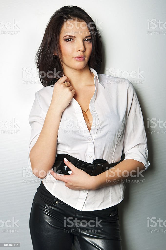 Young beautiful woman standing against a wall stock photo