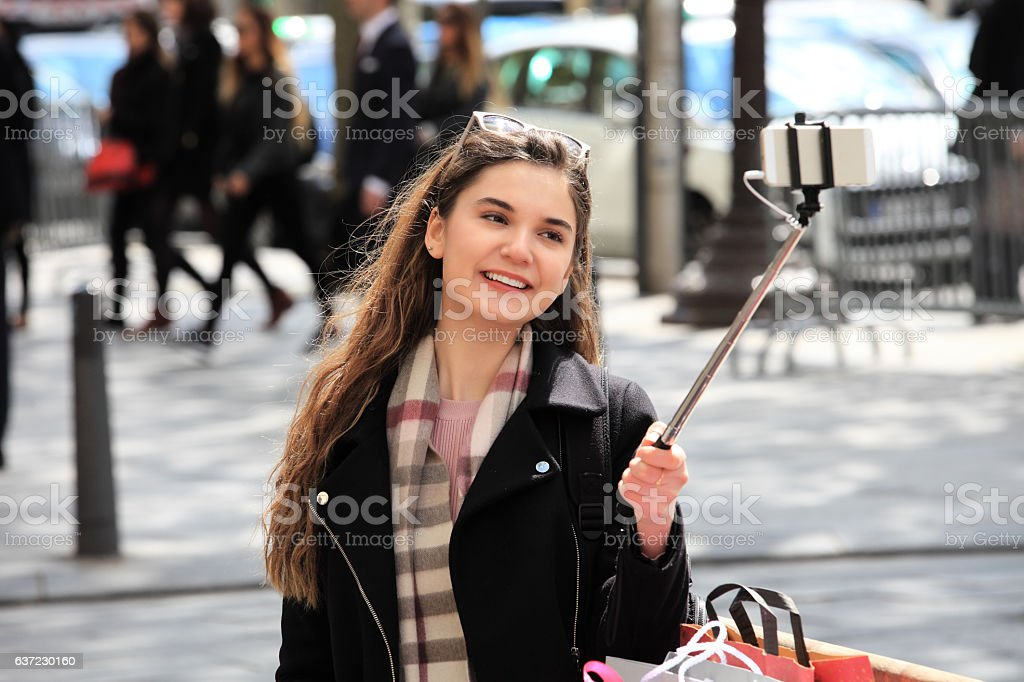 Young beautiful woman taking selfies in Paris stock photo
