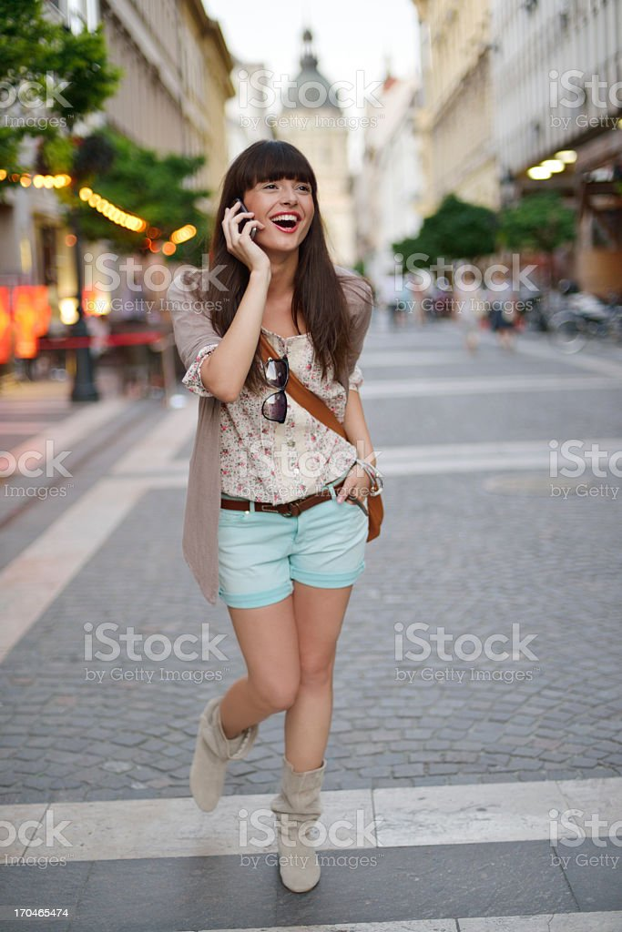 Young beautiful woman talking on phone in the city royalty-free stock photo