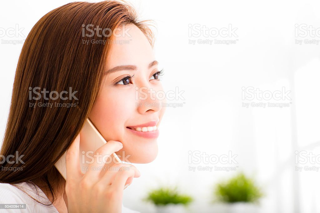 young beautiful woman talking on the phone stock photo