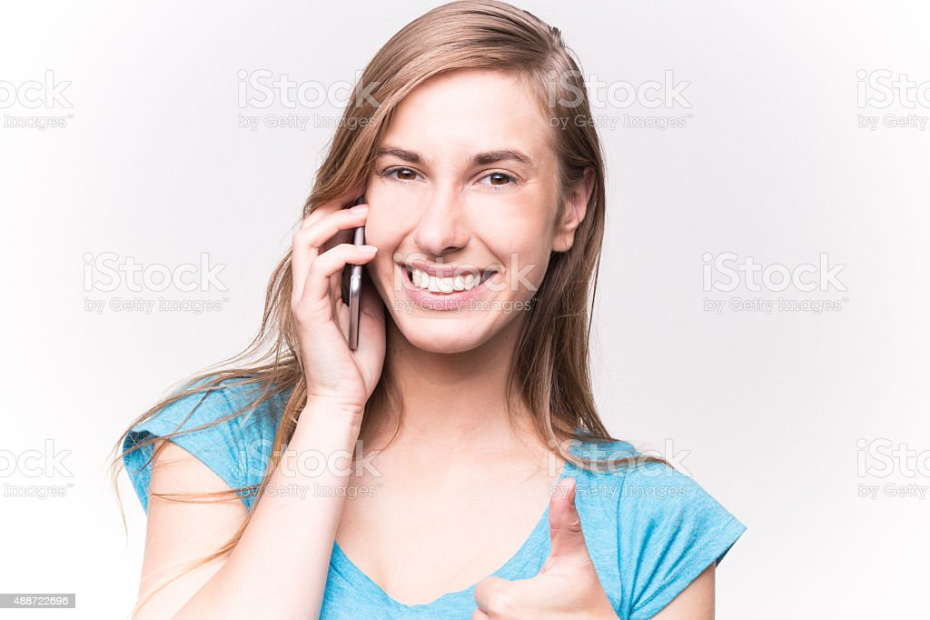 Young Beautiful woman Talking on the Phone White Background stock photo