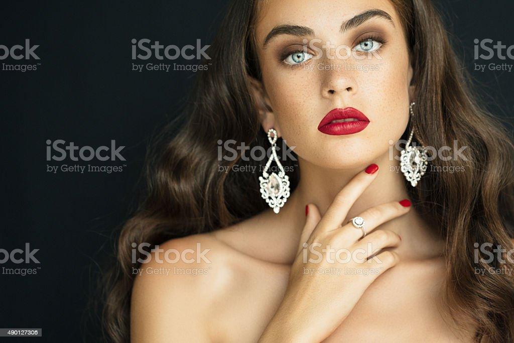 Young beautiful woman wearing earings haute couture stock photo
