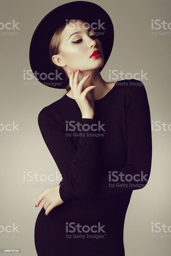 Young beautiful woman wearing retro hat stock photo