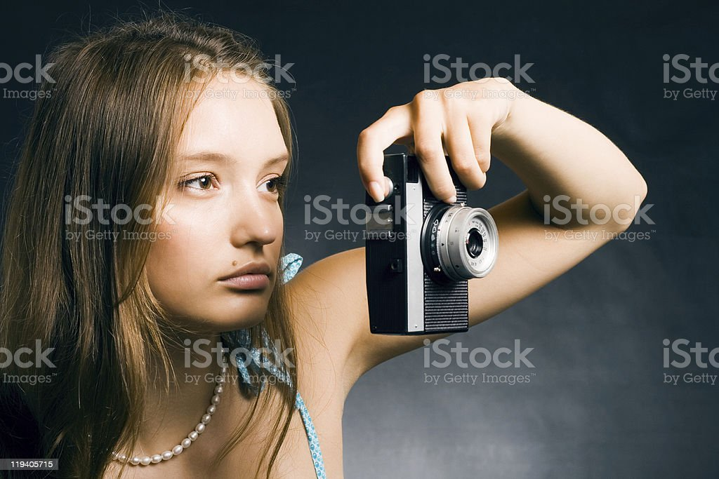 Young beautiful woman with a retro camera royalty-free stock photo