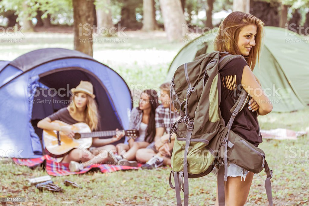 Young beautiful woman with backpak stock photo