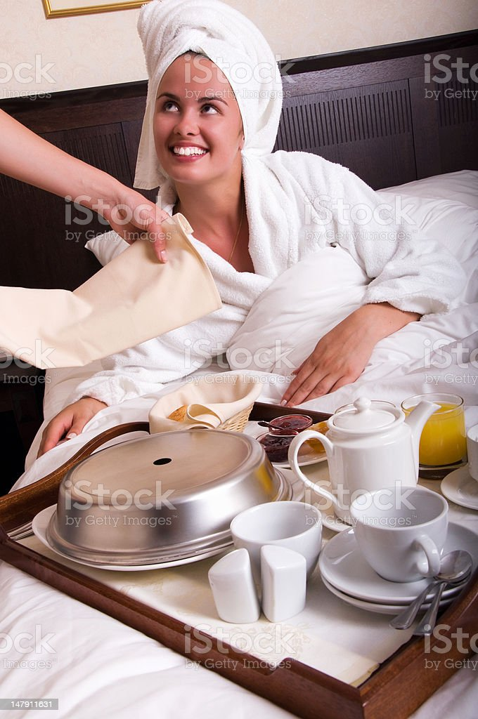 Young beautiful woman with breakfast in bed royalty-free stock photo