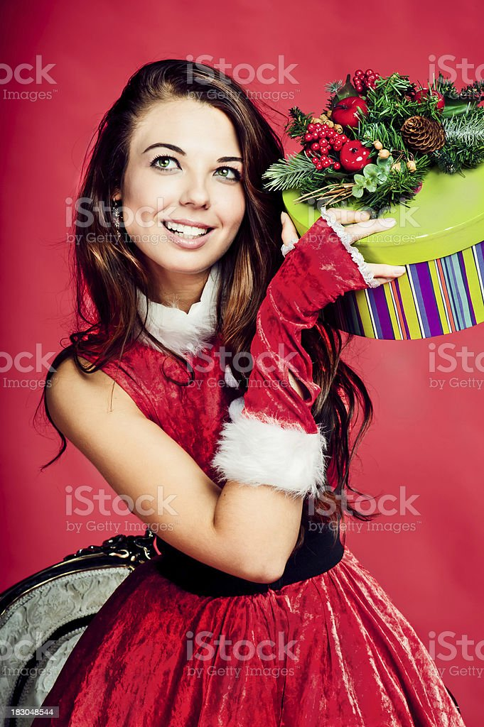 Young beautiful woman with Christmas present royalty-free stock photo
