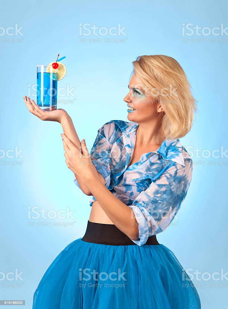 Young beautiful woman with cocktail 'Blue lagoon' stock photo