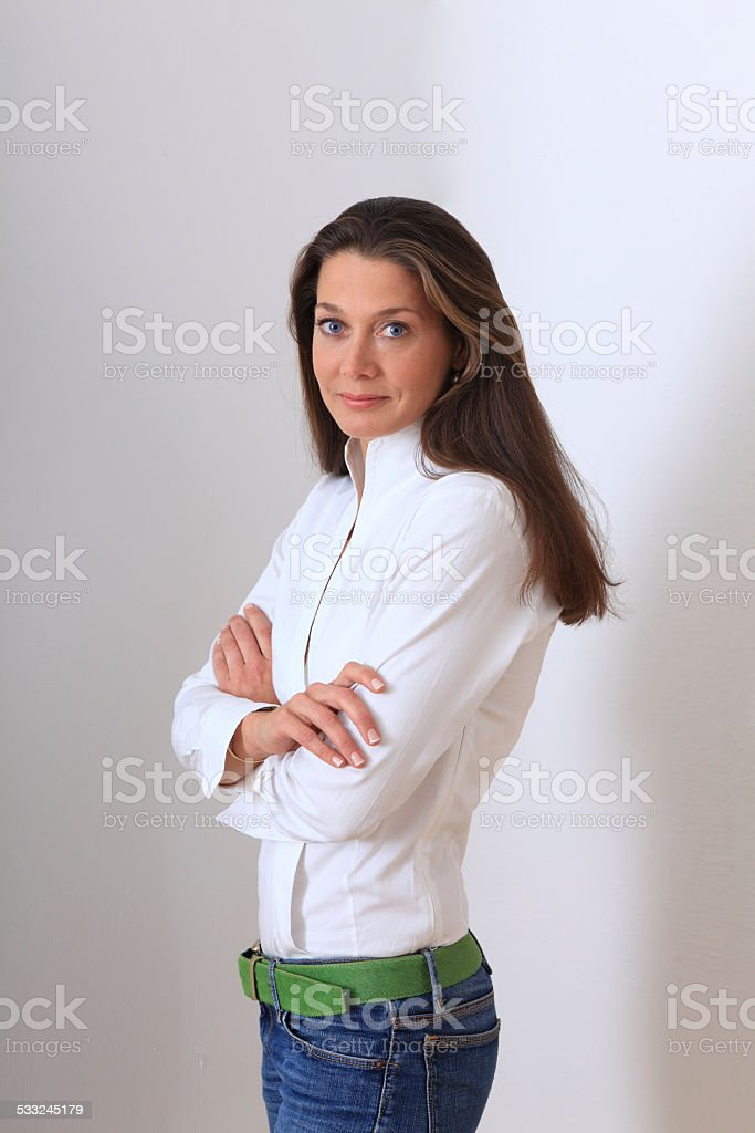 young beautiful woman with crossed arms stock photo