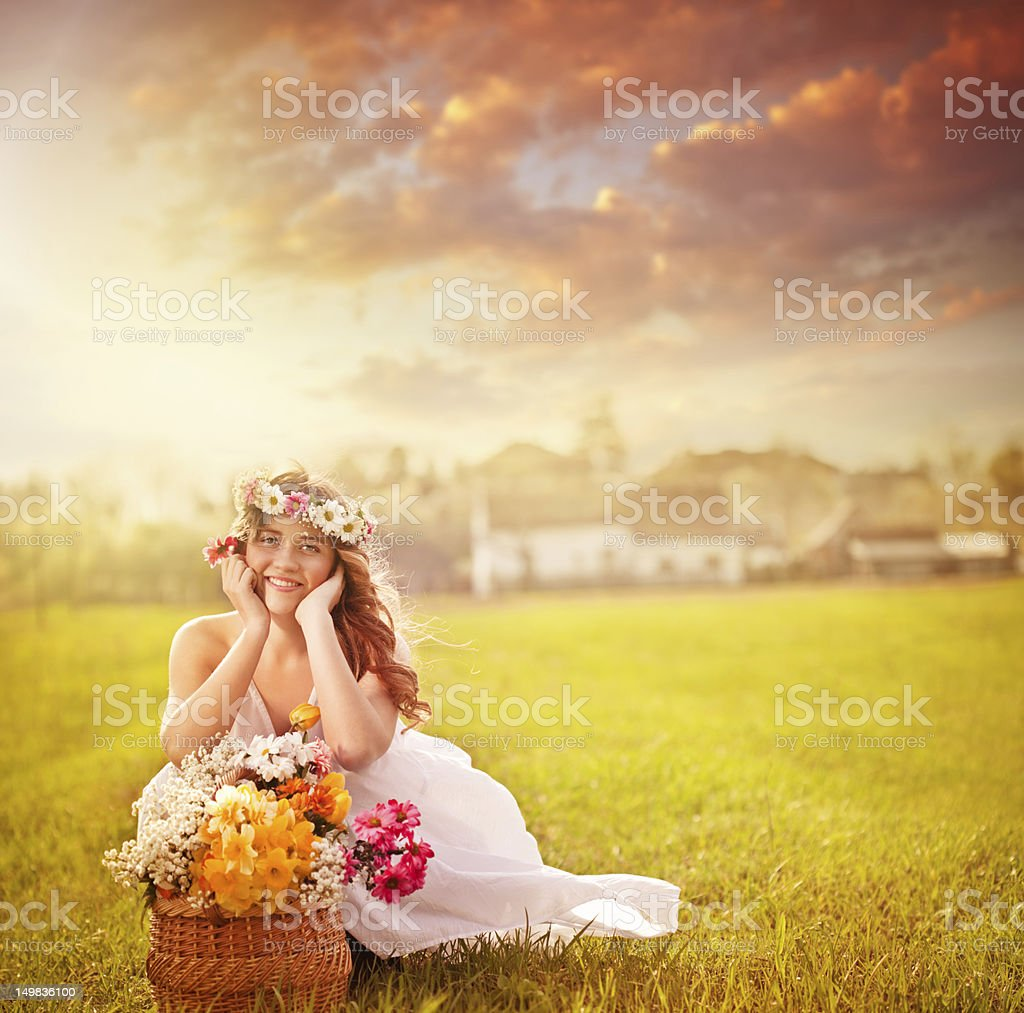 Young beautiful woman with flowers outdoors stock photo