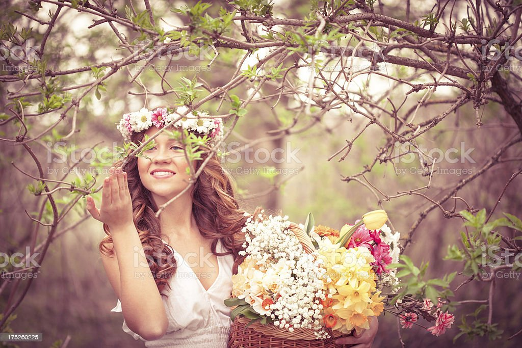 Young beautiful woman with flowers outdoors royalty-free stock photo