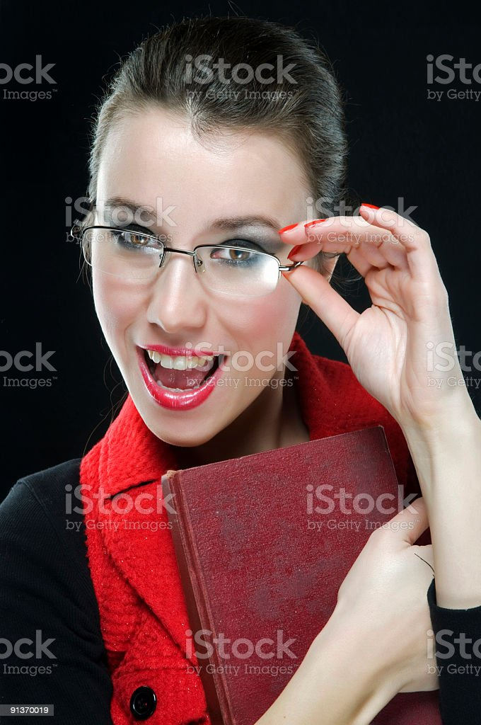 young beautiful woman with glasses and book stock photo