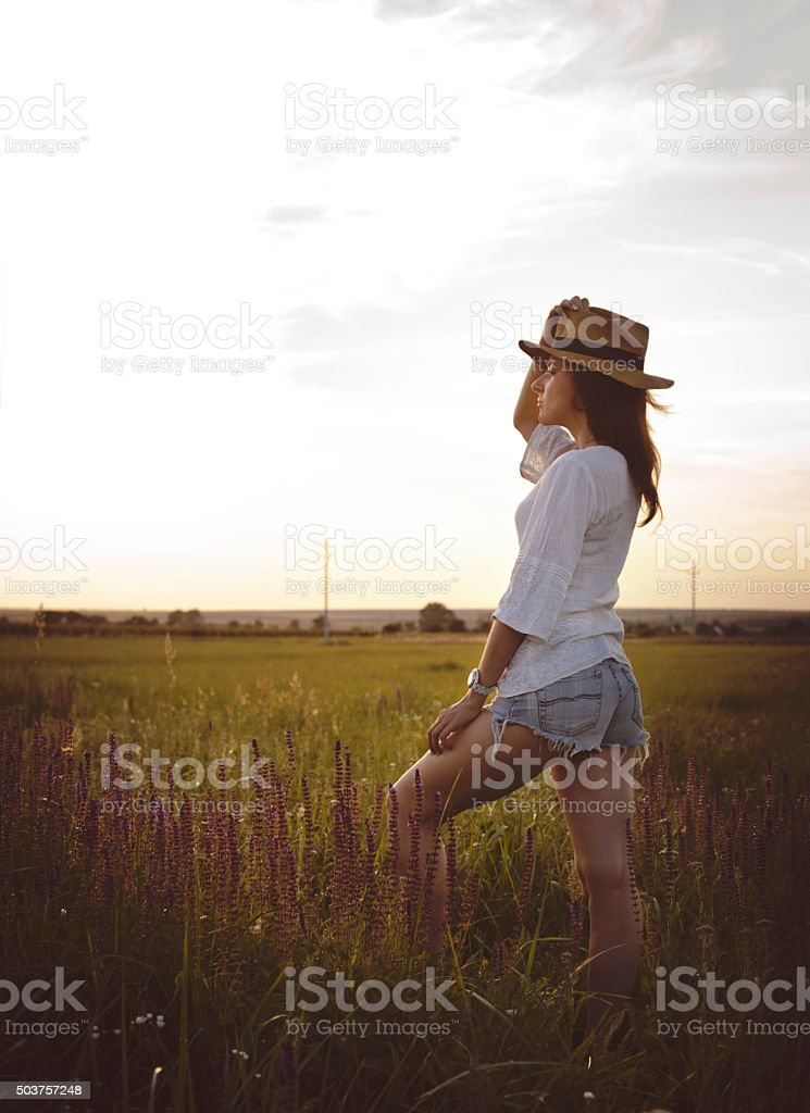 Young Beautiful Woman With Hat In Field stock photo