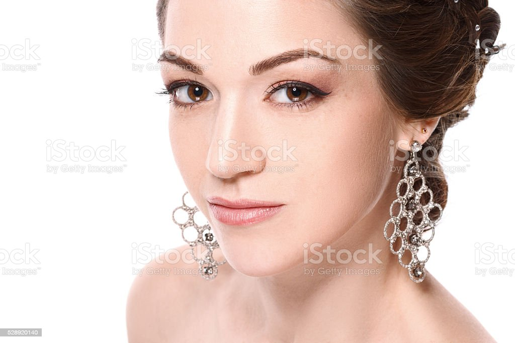 young beautiful woman with jewelry. Brunette girl. stock photo