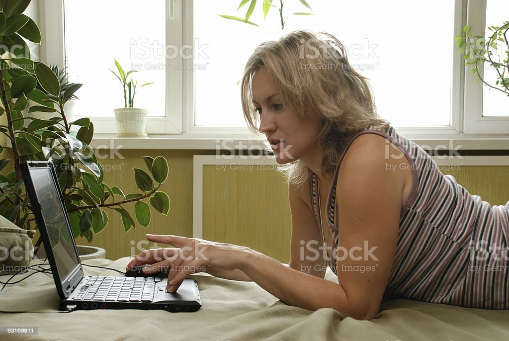 Young beautiful woman with laptop royalty-free stock photo