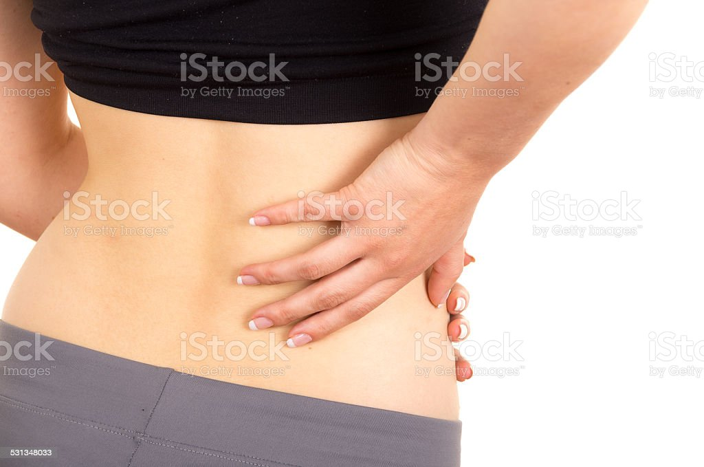 young beautiful woman with lower back pain stock photo