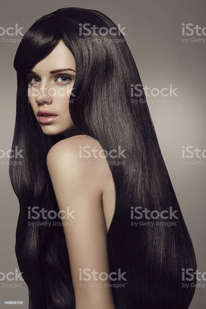 Young beautiful woman with luxury hair stock photo