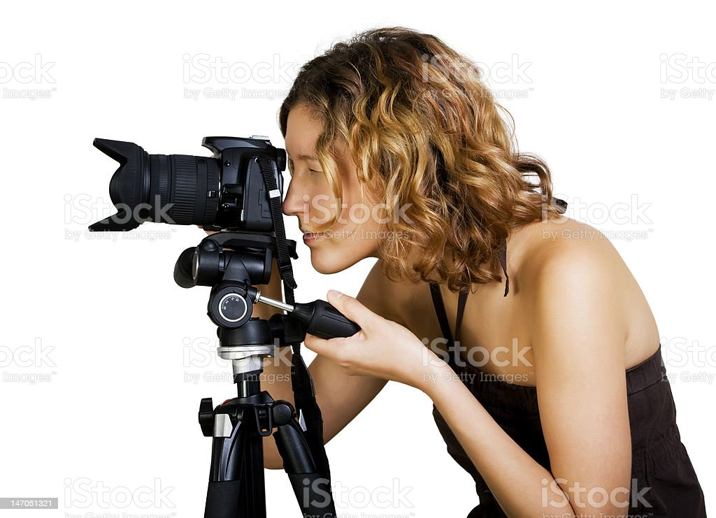 Young beautiful  woman  with photo camera and tripod stock photo