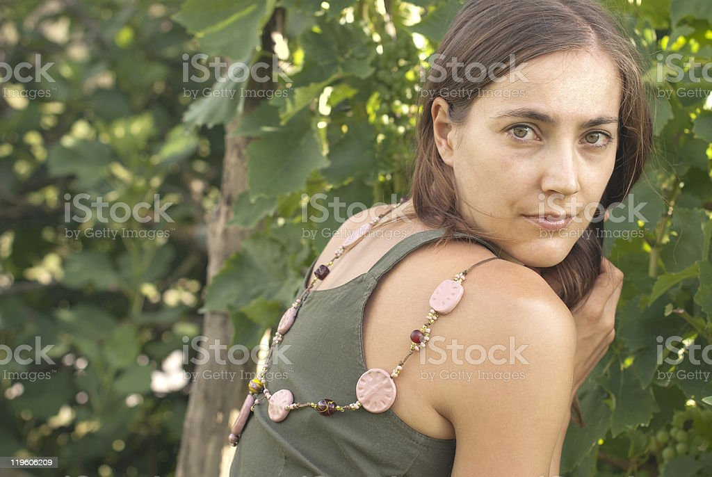 Young Beautiful Woman with Pink Necklace royalty-free stock photo
