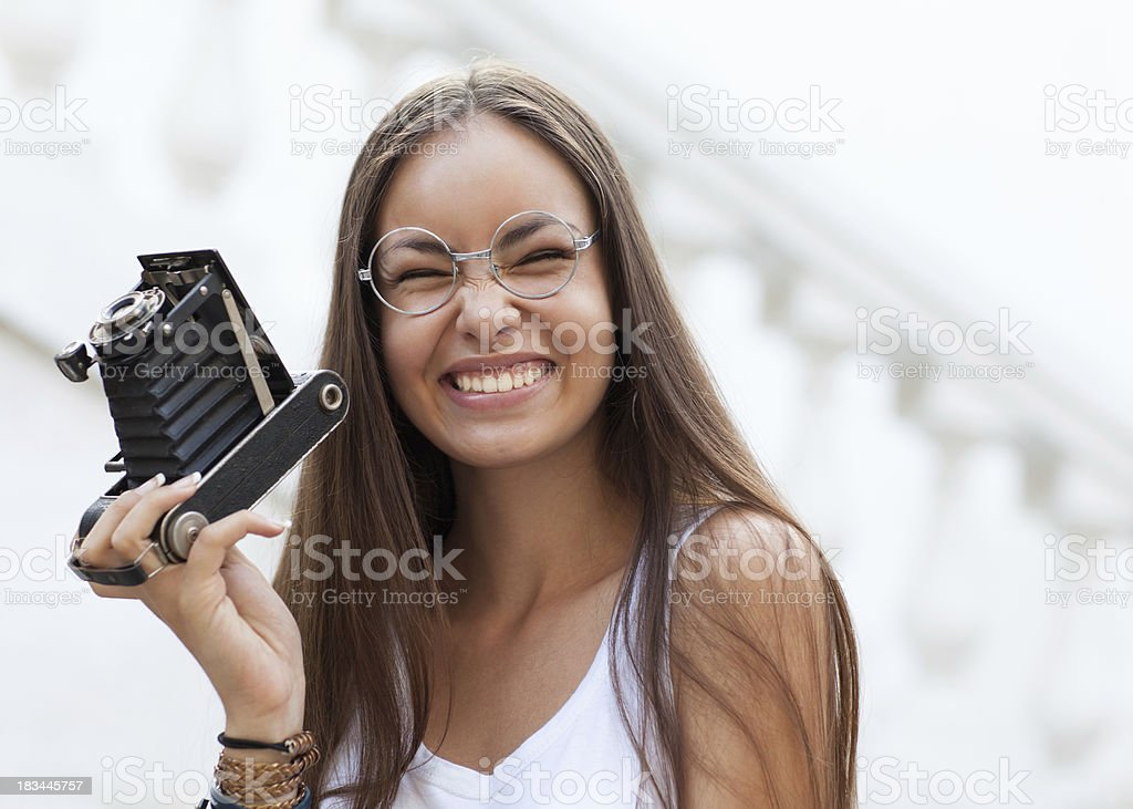Young, beautiful woman with retro camera. Hipster style .outdoor shot. royalty-free stock photo