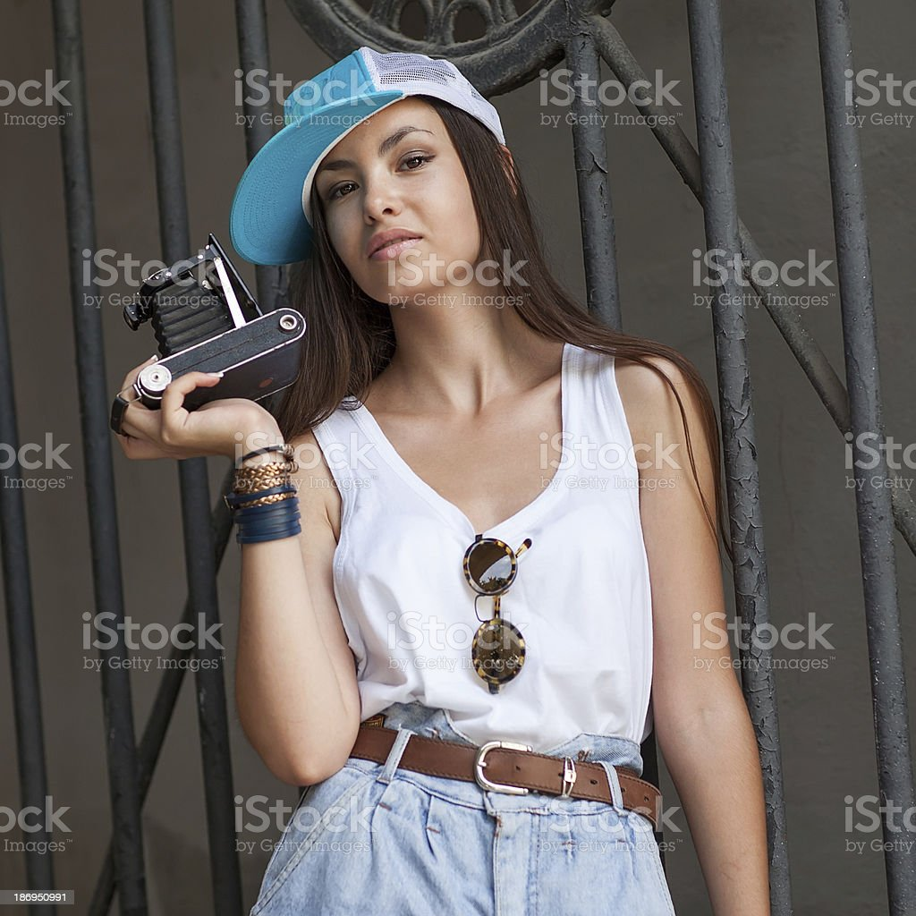 Young, beautiful woman with retro camera. Hipster style. outdoor shot. royalty-free stock photo