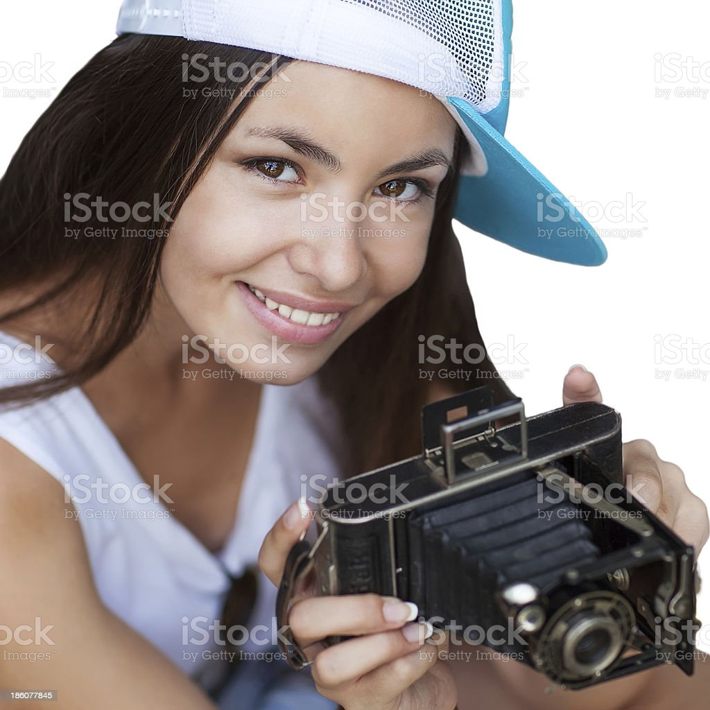 Young, beautiful woman with retro camera. Hipster style. Studio shot. royalty-free stock photo