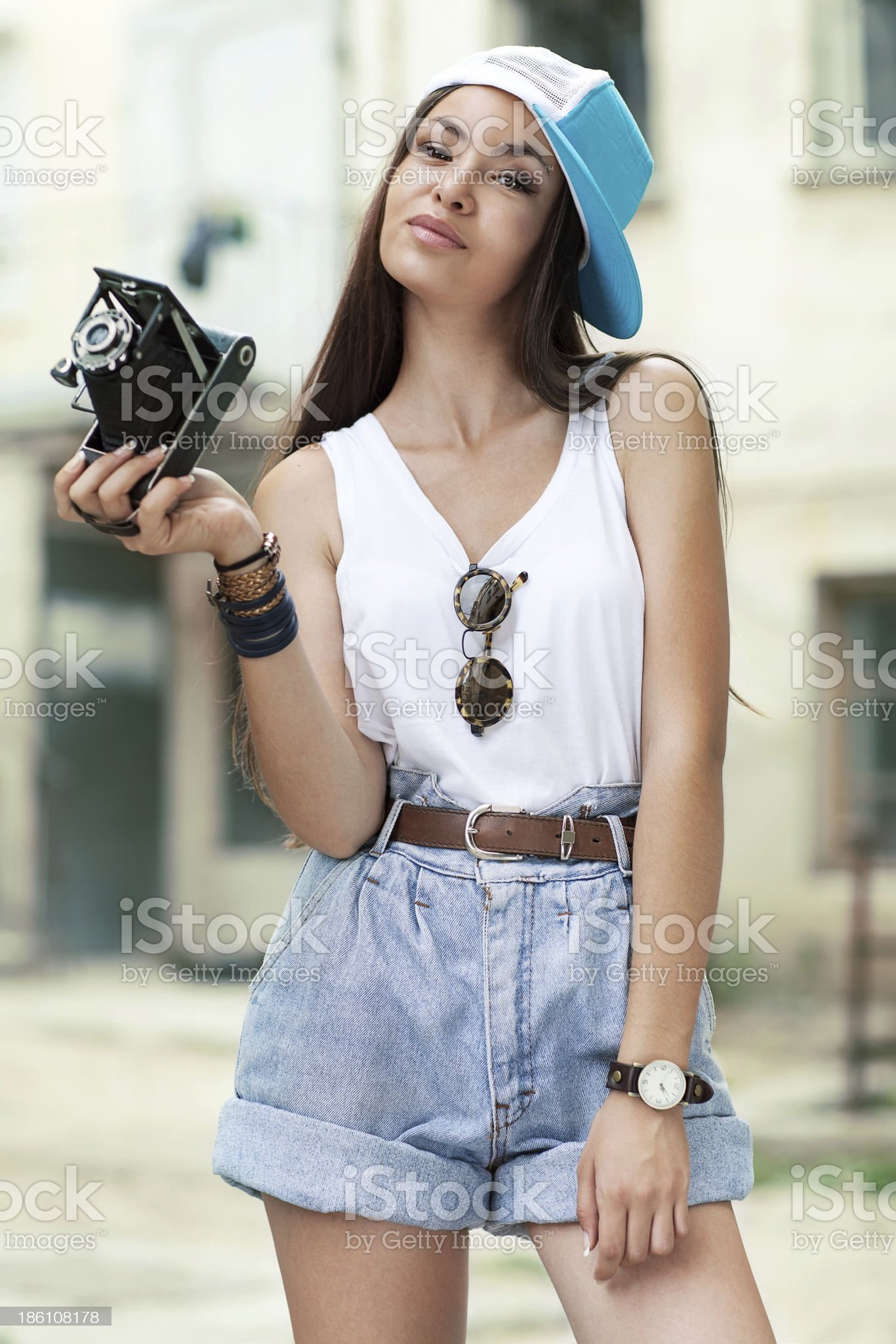 Young, beautiful woman with retro camera. royalty-free stock photo