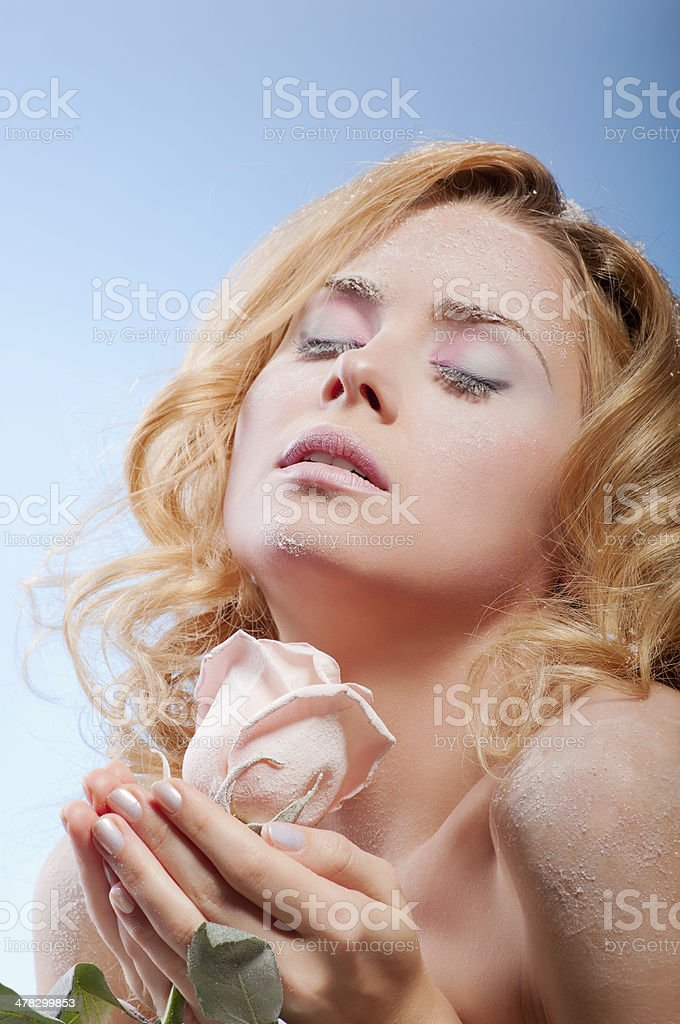 Young beautiful woman with snowy skin royalty-free stock photo