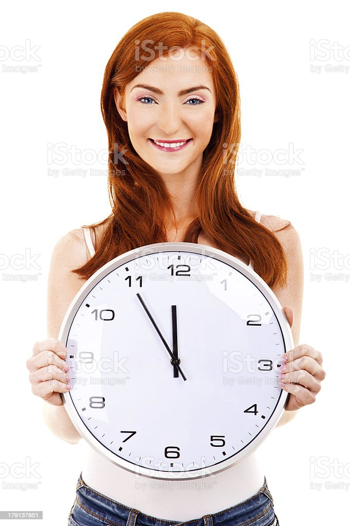 Young beautiful woman with the clock isolated in white royalty-free stock photo