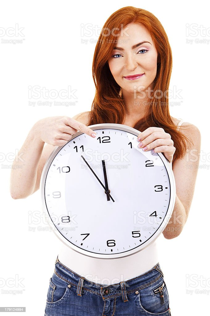 Young beautiful woman with the clock isolated in white pointing royalty-free stock photo