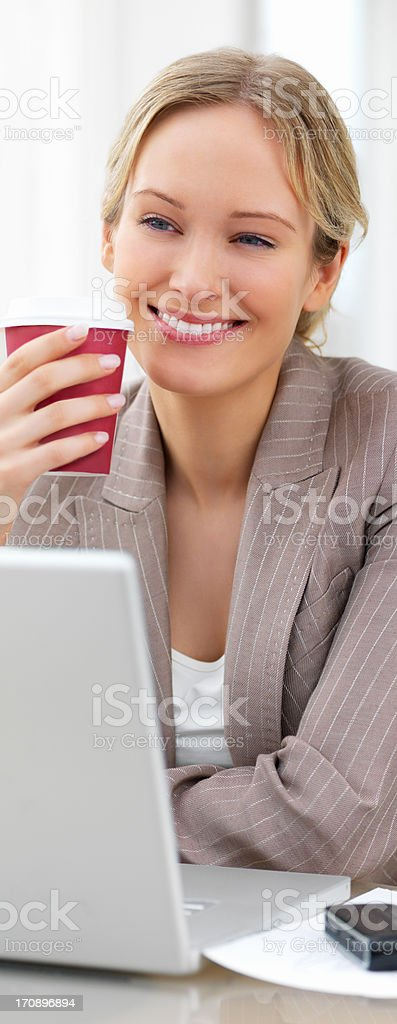 Young beautiful woman working on computer stock photo