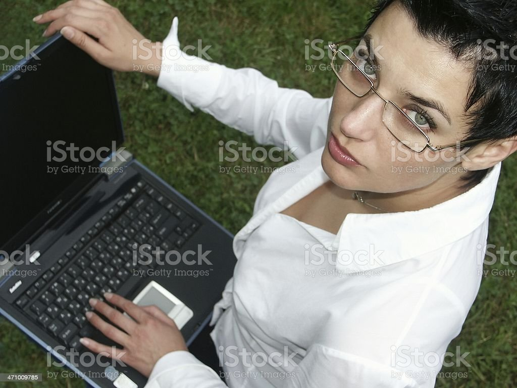 young beautiful woman working on notebook royalty-free stock photo