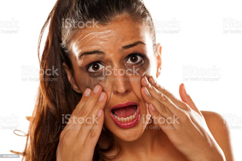 Young beautiful women applied a cream to remove her makeup stock photo