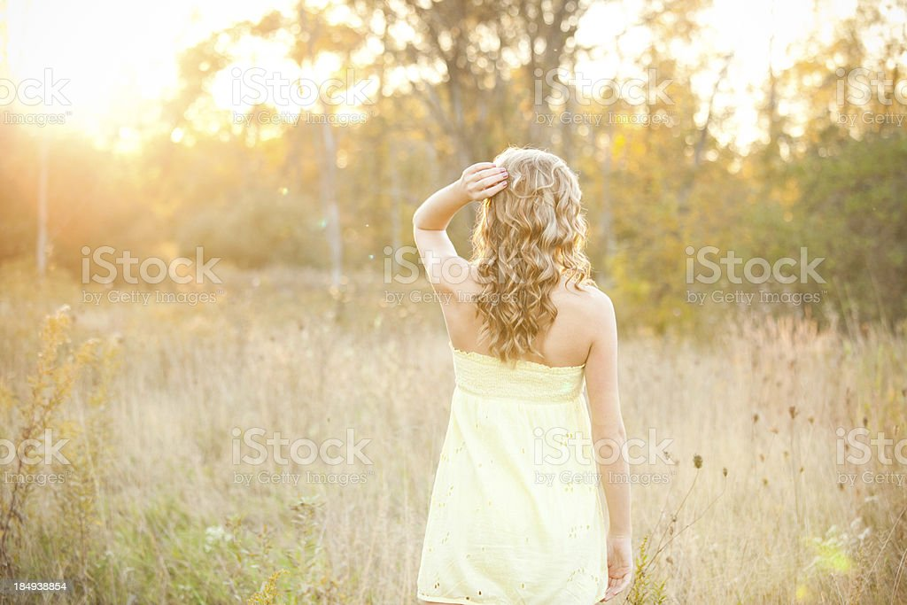 Young Beautiful Women in Sun Drenched Field royalty-free stock photo