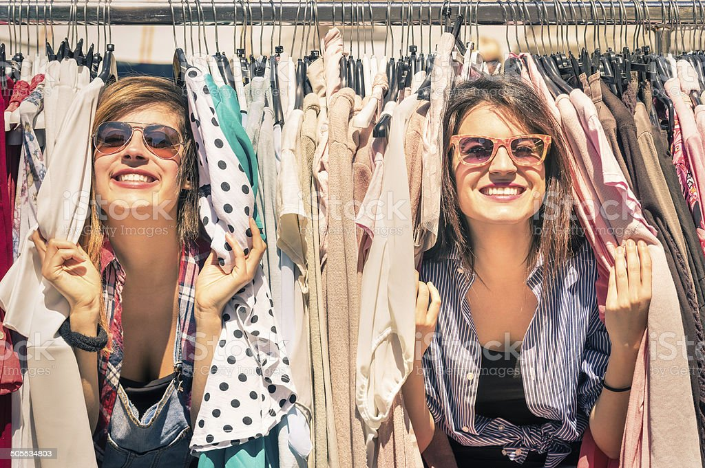 Young beautiful women shopping at the weekly cloth market stock photo