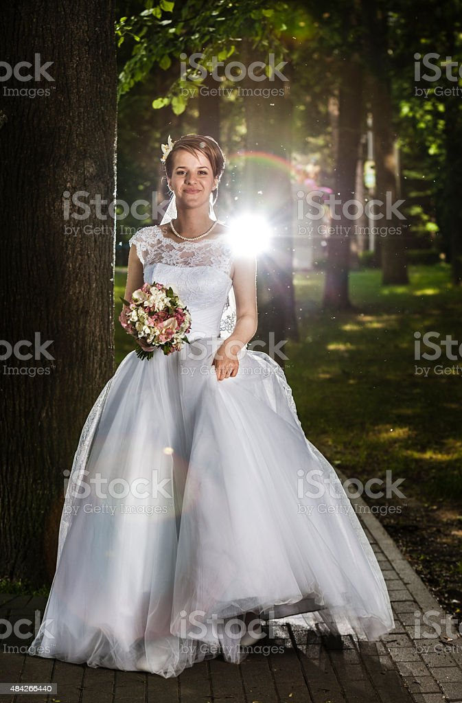 Young beautiful women, the bride, in the park stock photo