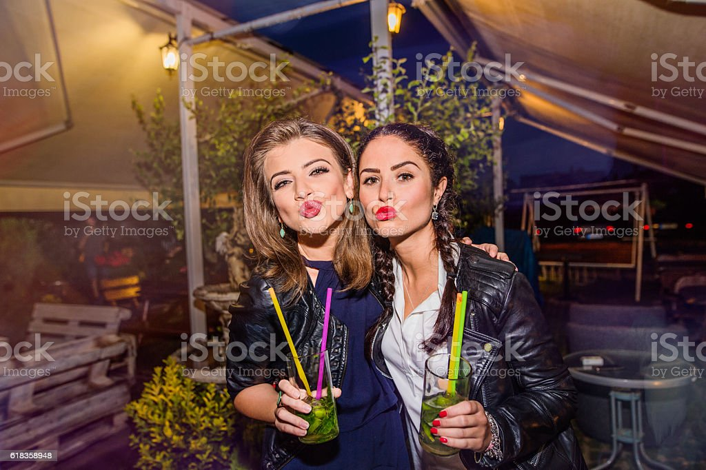 Young beautiful women with cocktails in bar or club stock photo
