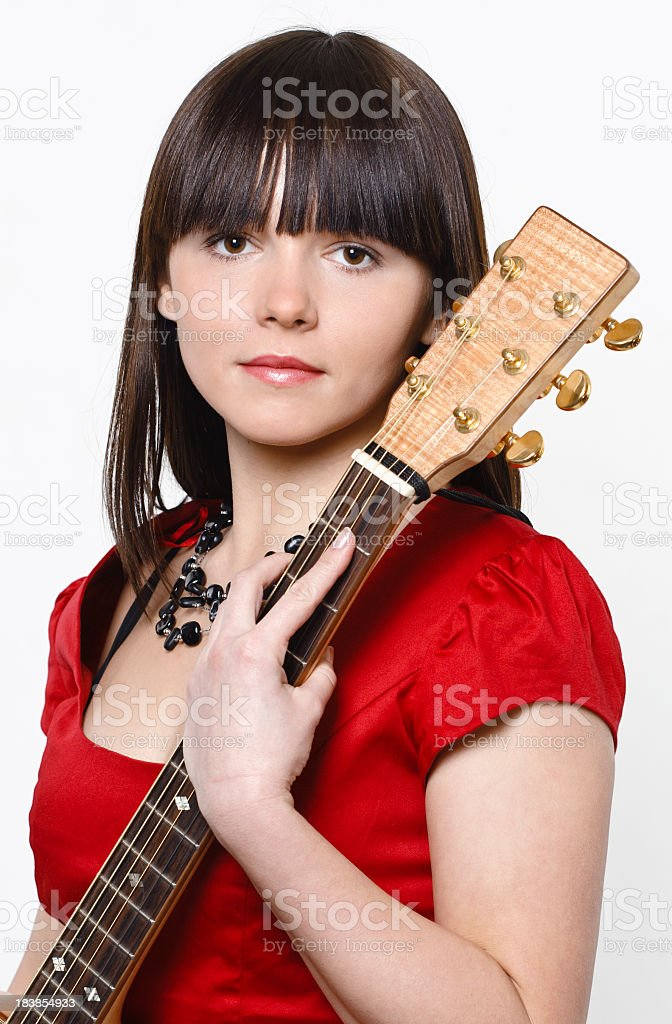 Young beautifull woman with guitar stock photo