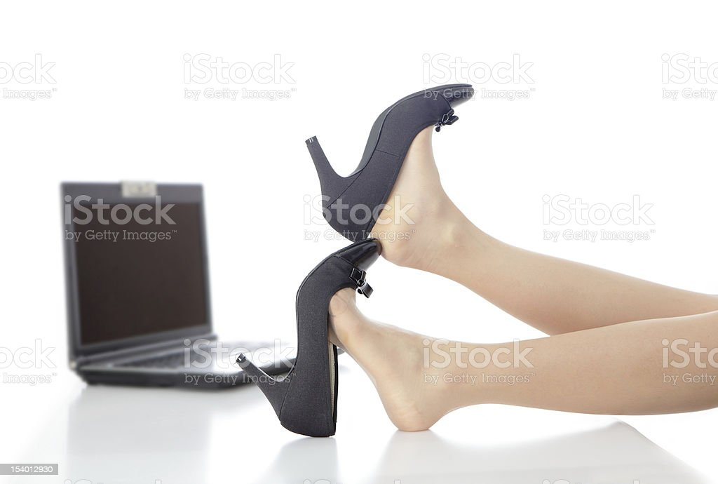 Young Beauty business woman take off shoes in office royalty-free stock photo